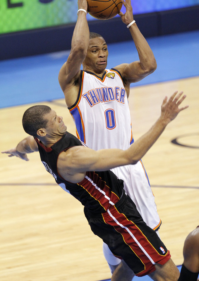 Oklahoma City's Russell Westbrook (0) passes the ball past Miami's Shane Battier (31) during Game 2 of the NBA Finals between the Oklahoma City Thunder and the Miami Heat at Chesapeake Energy Arena in Oklahoma City, Thursday, June 14, 2012. Photo by Chris Landsberger, The Oklahoman