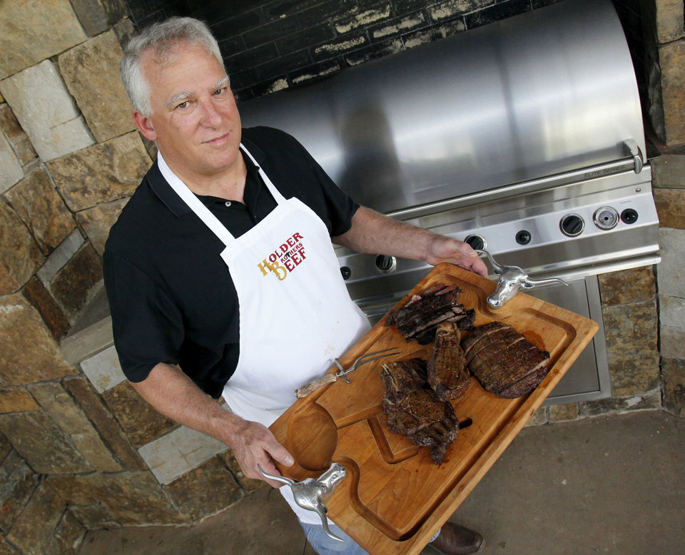 Photo - Rick Holder of Holder Brothers Beef holds grilled steaks, in Oklahoma City, Friday, May 25, 2012.  Photo by Nate Billings, The Oklahoman