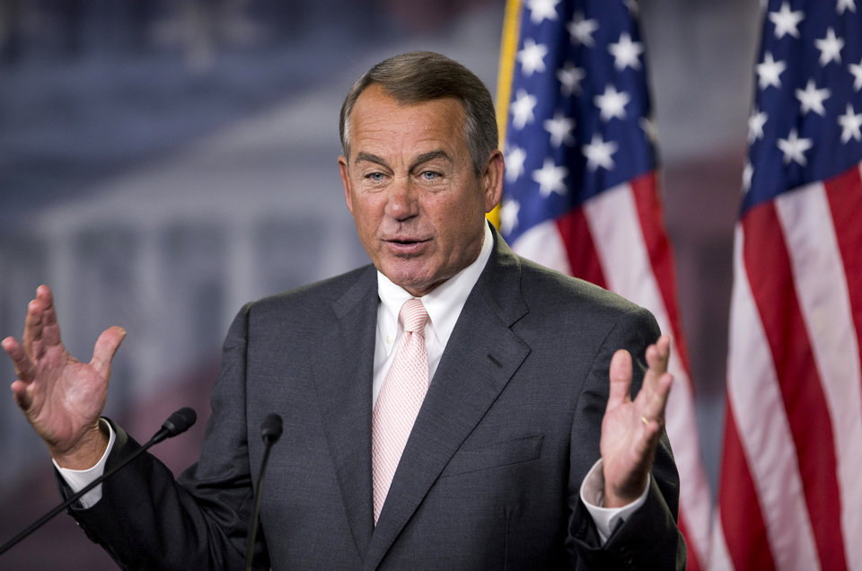 Photo - House Speaker John Boehner of Ohio, speaks to reporters on Capitol Hill in Washington, Thursday, July 10, 2014, during a news conference. (AP Photo/Manuel Balce Ceneta)