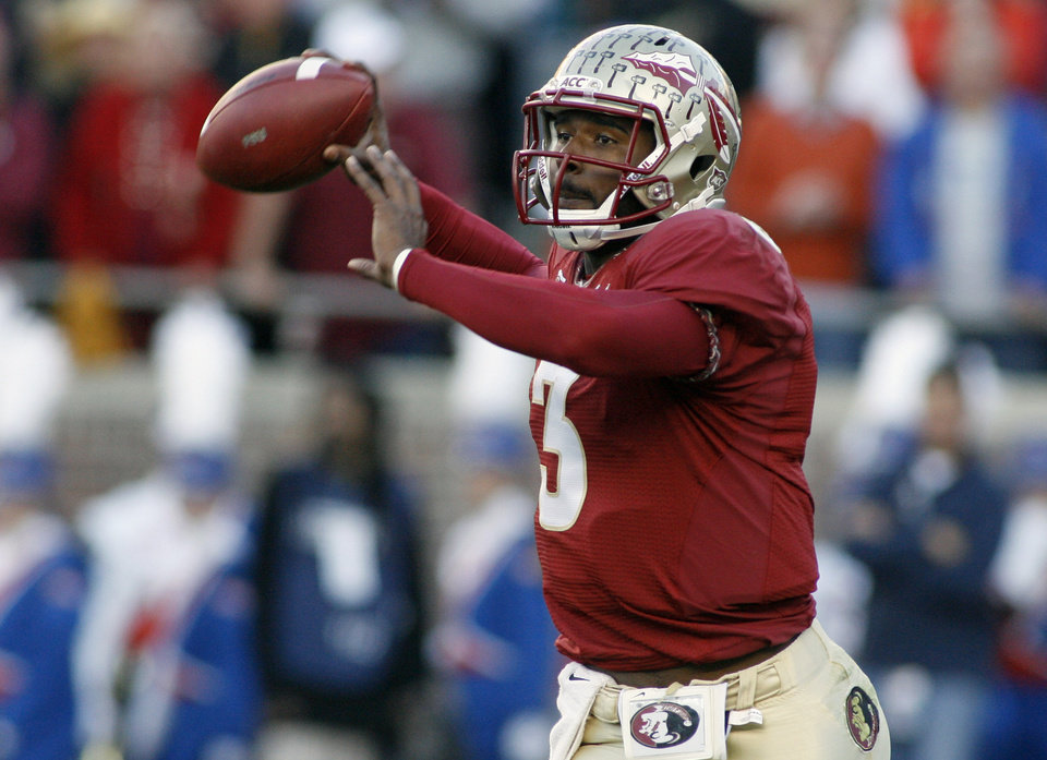Photo - Florida State quarterback EJ Manuel throws a pass against Florida during the first half of an NCAA college football game, Saturday, Nov. 24, 2012, in Tallahassee, Fla. (AP Photo/Phil Sears)