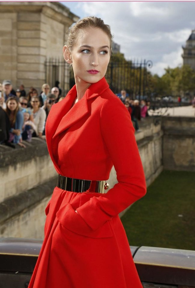 Photo - During Paris Fashion Week in late September, Sobieski was once again turning heads with her slightly offbeat, chic fashion sense. She made an appearance at the Christian Dior show in a red wool coat, bulky metallic belt and demure mauve heels.