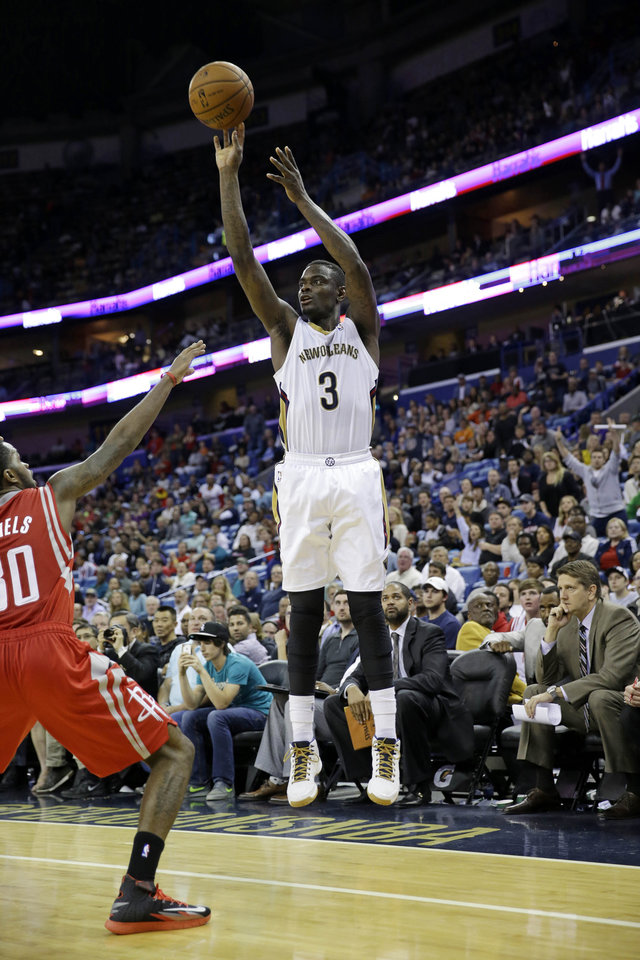 Photo - New Orleans Pelicans guard Anthony Morrow (3) shoots in the second half of an NBA basketball game against the Houston Rockets in New Orleans, Wednesday, April 16, 2014. The Pelicans won 105-100. (AP Photo/Gerald Herbert)
