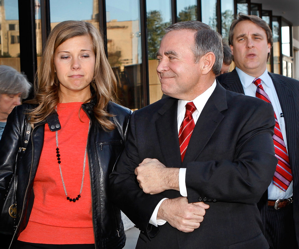 Former State Senate leader Mike Morgan holds tightly to the arm of his daughter, Abby, and gives her a smile as they emerge from the Federal Courthouse in Oklahoma City Monday afternoon, March 5, 2012. Behind Morgan is attorney David Ogle. Morgan was found guilty of one bribery count at his political corruption trial at the Oklahoma City federal courthouse. The jury acquitted him or deadlocked on 61 other counts. Photo by Jim Beckel, The Oklahoman