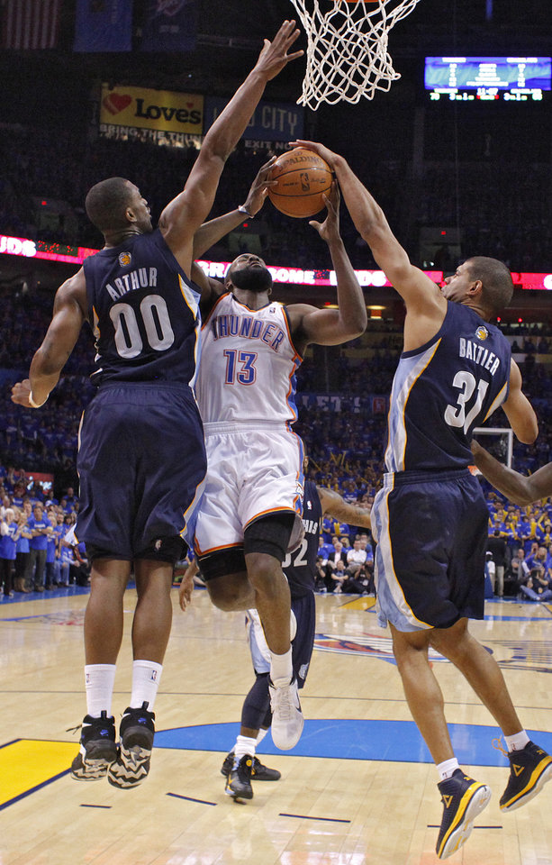 Oklahoma City's James Harden (13) is hit under the basket by Darrell Arthur (00) of Memphis and Shane Battier (31) of Memphis during game two of the Western Conference semifinals between the Memphis Grizzlies and the Oklahoma City Thunder in the NBA basketball playoffs at Oklahoma City Arena in Oklahoma City, Tuesday, May 3, 2011. Photo by Chris Landsberger, The Oklahoman