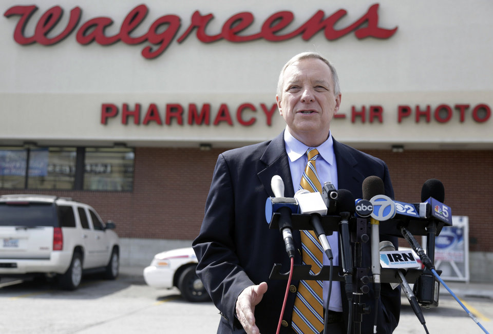 Photo - U.S. Sen. Dick Durbin, D-Ill. speaks during a news conference outside a Walgreen's drugstore Wednesday, Aug. 6, 2014, in Chicago. Durbin praised Walgreen, the nation's largest drugstore chain, for declining to pursue an overseas reorganization to trim its U.S. taxes. (AP Photo/M. Spencer Green)