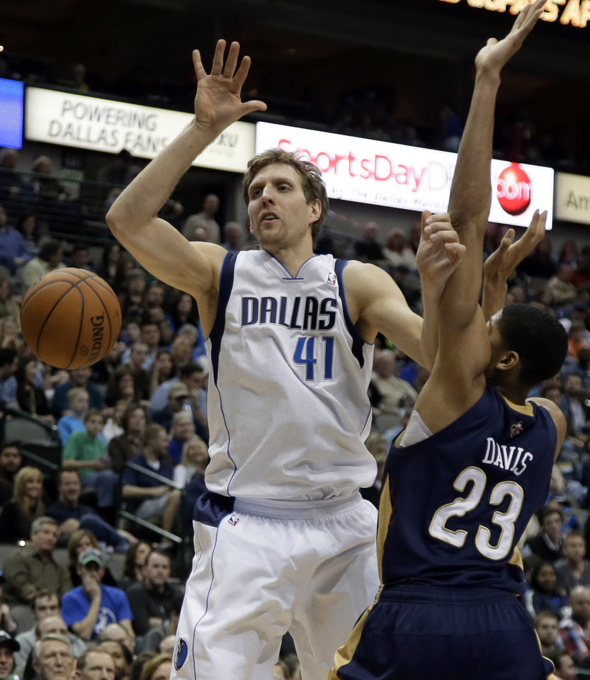 Dallas Mavericks power forward Dirk Nowitzki (41) loses control of the ball after being fouled by New Orleans Pelicans' Anthony Davis (23) on a shot attempt in the first half of an NBA basketball game, Saturday, Jan. 11, 2014, in Dallas. (AP Photo/Tony Gutierrez)
