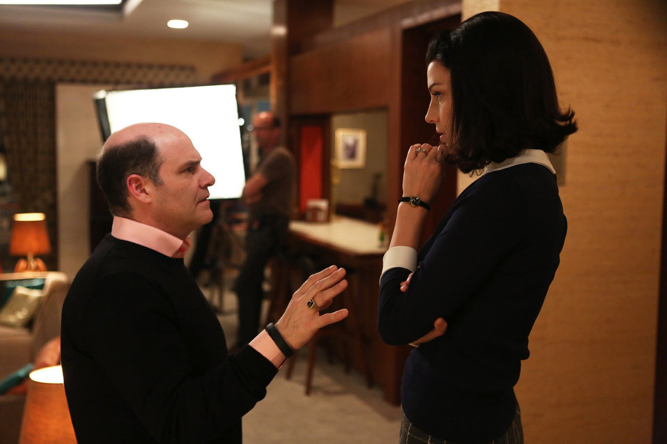Photo - In this photo released by AMC, creator Matthew Weiner, left, talks with actress Jessica Pare on the set of the TV series,
