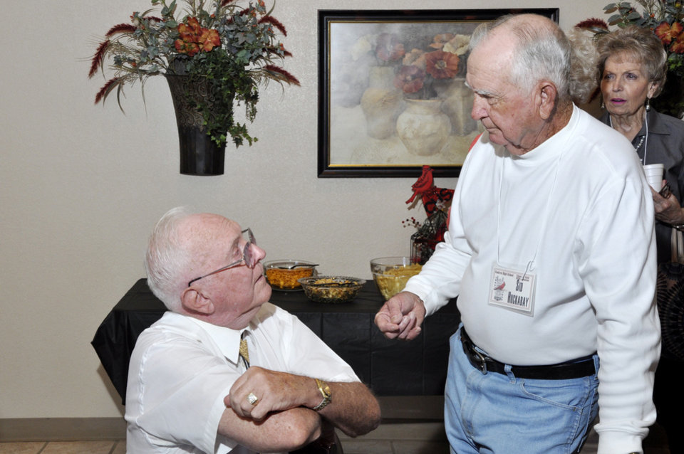 Photo - Bob Johnson and Sid Huckabay chat during the 65th Central High School reunion on Sept. 21. Photo by M. Tim Blake, for The Oklahoman  M. Tim Blake