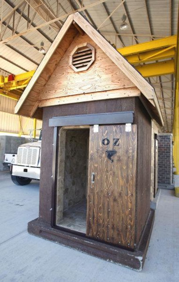 Photo - An above-ground safe room with a pitched roof added for decoration built by Oz Saferooms in Del City.  PAUL B. SOUTHERLAND - The Oklahoman