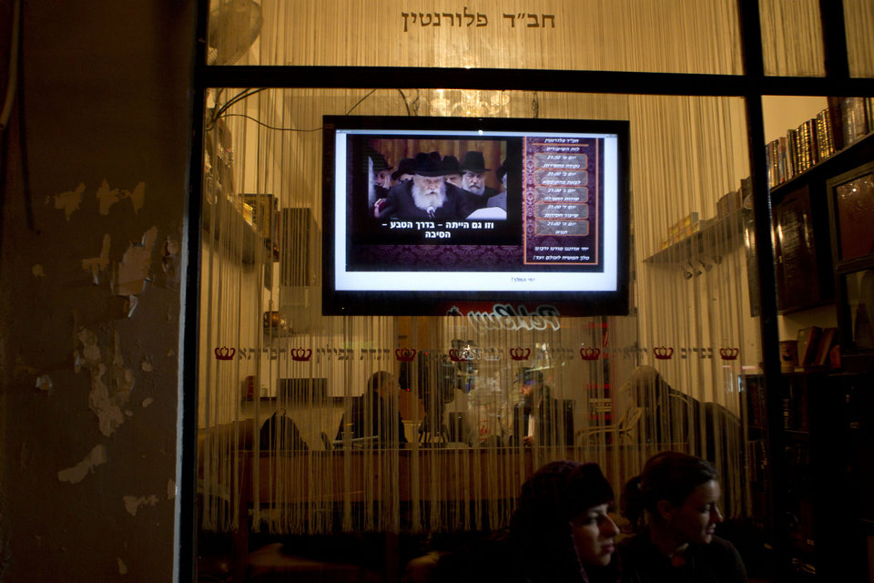 Photo - In this photo taken on Tuesday, Dec. 4, 2012, students sit outside of the Cain and Abel School for Prophets founder  in Tel Aviv, Israel. Instead of long beards and robes, they wear track suits and T-shirts. Their tablets are electronic, not hewn of stone, and they hold smartphones, not staffs. They may not look the part, but this ragtag group of Israelis is training to become the next generation of prophets. For just 200 shekels ($53) and in only 40 short classes, anyone can become a certified, modern-day soothsayer at the Cain and Abel School for Prophets.(AP Photo/Ariel Schalit)