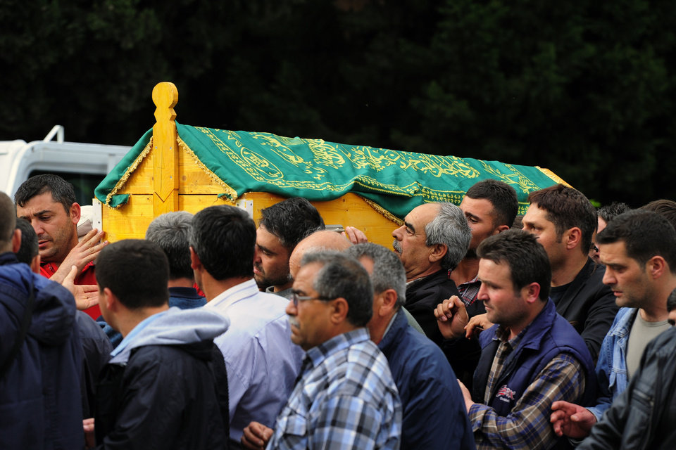 Photo - Pall bearers carry the coffin of a mine accident victim for burial in Soma, Turkey, Wednesday, May 14, 2014.  Nearly 450 miners were rescued, the mining company said, but the fate of an unknown number of others remained unclear as bodies are still being brought to the surface and burials are underway after one of the world's deadliest mining disasters.(AP Photo/Emre Tazegul)