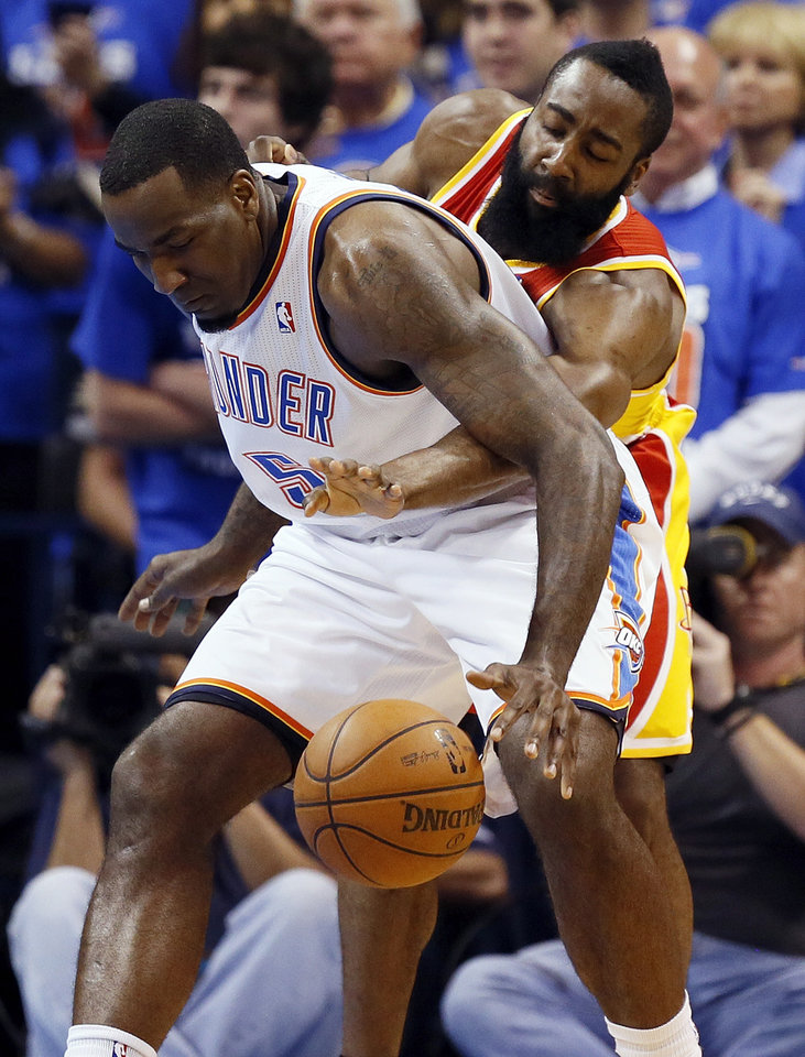 Photo - Houston's James Harden (13) tries to knock the ball away from Oklahoma City's Kendrick Perkins (5) in the first half during Game 5 in the first round of the NBA playoffs between the Oklahoma City Thunder and the Houston Rockets at Chesapeake Energy Arena in Oklahoma City, Wednesday, May 1, 2013. Photo by Nate Billings, The Oklahoman
