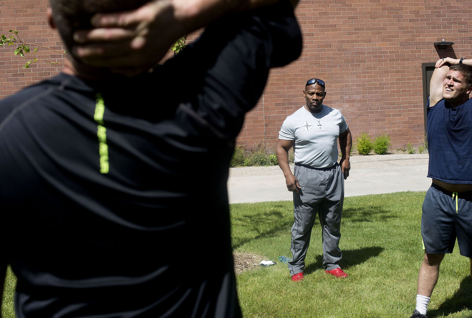 Photo -       Ron Williams, center, a nondenominational Christian pastor, leads an exercise group of Utah National Guard members at their headquarters on Thursday, Aug. 14, 2014. (Laura Seitz, Deseret News)