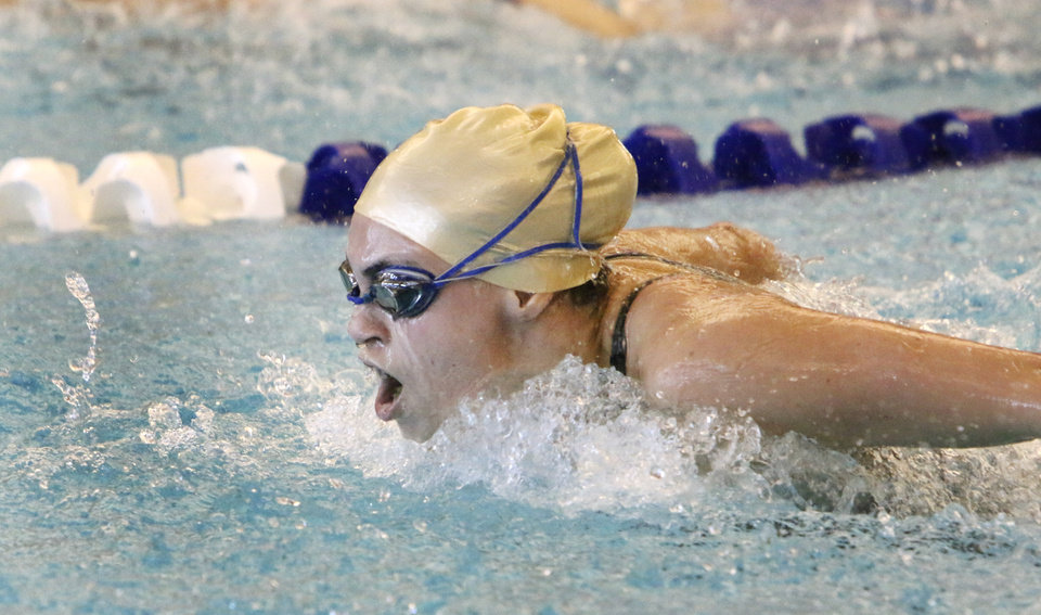 Photo - Heritage Hall's Milly Bock competes in the 100 yard butterfly during the Class 5A State Championships at the Edmond Aquatic Center, Friday February 21, 2014. Photo By Steve Gooch, The Oklahoman
