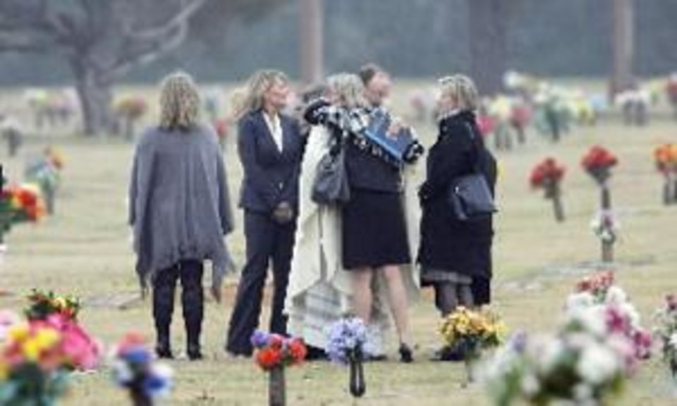 Photo - Funeral of 9-year-old  Tommy  Wolf at the Resurrection Catholic Cemetery, Friday , November 20, 2009. By David McDaniel, The Oklahoman.