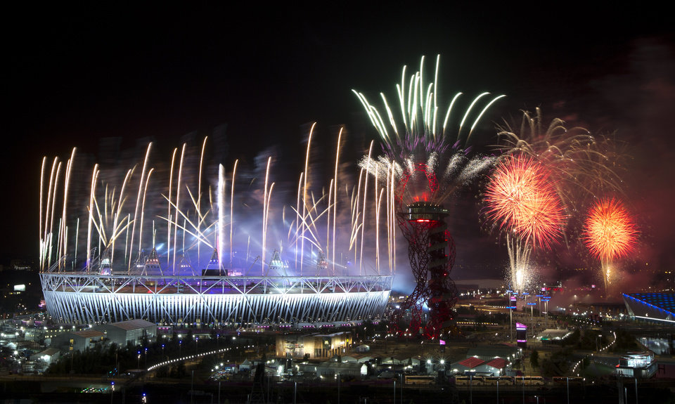 Fireworks explode over the Olympic Stadium at the closing ceremony of the 2012 Summer Olympics, Monday, Aug. 13, 2012, in London.  AP photo