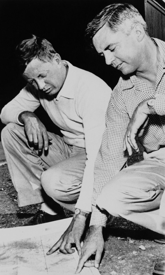 Photo - FILE - In this July 1, 1956, file photo, Palen Hudgin, right, shows his brother, Henry, where the two planes crashed on June 30, 1956 killing 128 people in the Grand Canyon. The crash spurred improvements to the air traffic control and radar systems, and led to the creation of the Federal Aviation Administration. On Tuesday, July 8, 2014, the Grand Canyon National Park will mark the designation of the crash site as a National Historic Landmark in a ceremony overlooking the gorge where the wreckage was scattered over 1.5 square miles. (AP Photo/File)