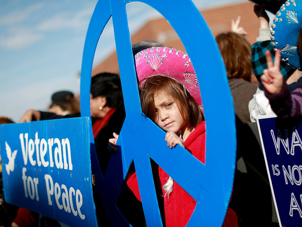 Photo - Maggie Friend, age 8, rides with the Peace House float during the Martin Luther King Jr. Day Parade in Oklahoma City on Monday, Jan. 17, 2011. Photo by John Clanton, The Oklahoman