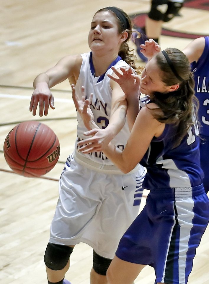 Photo - Okarche's Rae Grellner (13) fights for a loose ball with Burlington's Heather Armbruster (10) during the Class B girls state basketball quarterfinal game between Okarche and Burlington at Southern Nazarene University in Bethany, Okla. on Thursday, March 6, 2014.  Photo by Chris Landsberger, The Oklahoman