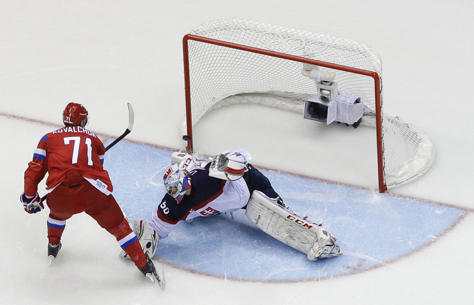 Photo - Russia forward Ilya Kovalchuk flips the puck past Slovakia goaltender Jan Laco to win a shootout during a men's ice hockey game at the 2014 Winter Olympics, Sunday, Feb. 16, 2014, in Sochi, Russia. Russia won 1-0. (AP Photo/Mark Humphrey )