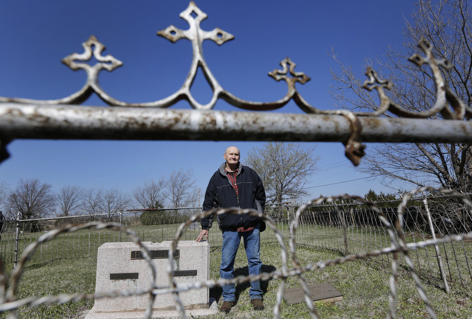 Photo - Bill Hediger stands next to headstones for his grandparents and his father at the Lutheran cemetery on NW 150th street in Oklahoma City , Thursday April 11, 2013. Photo By Steve Gooch, The Oklahoman ORG XMIT: OKC1303121532440650