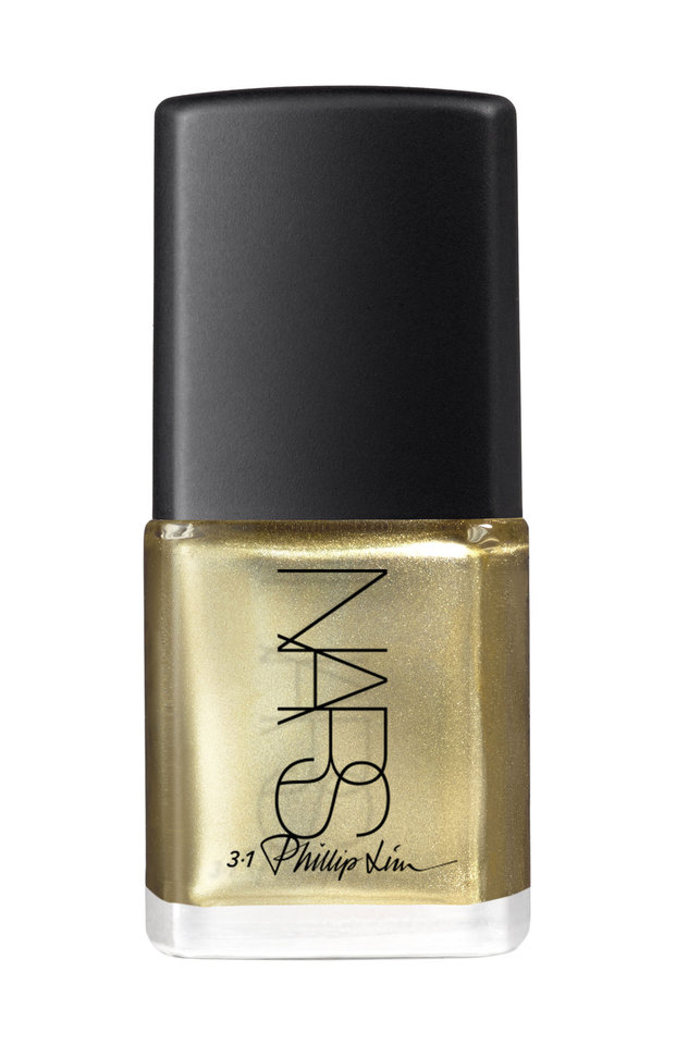Photo - This image released by 3.1 Phillip Lim for Nars shows gold nail polish. Move over, studded bracelets and chandelier earrings. Right now, it's all about nails. Nails have become a growth market for designers: Phillip Lim and his 3.1 Phillip Lim brand have a new collaboration with Nars.  (AP Photo/3.1 Phillip Lim for Nars)