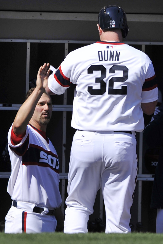 Photo - Chicago White Sox's Adam Dunn (32) celebrates with teammate Paul Konerko left, after hitting a solo home run against the Minnesota Twins during the seventh inning of a baseball game in Chicago, April 21, 2013. Minnesota won 5-3. (AP Photo/Paul Beaty)