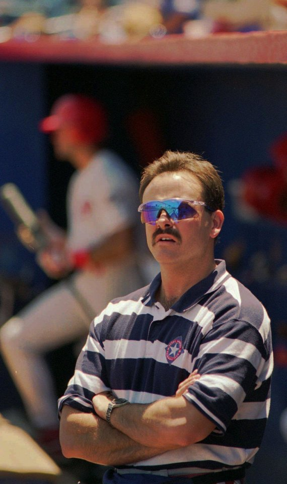 Oklahoma City 89ers baseball trainer Greg Harrel watches the action on the field from the 89er dugout in 1996.  <strong>JIM BECKEL - ARCHIVE PHOTO, JIM BECKEL</strong>