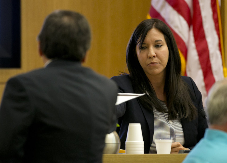 Photo - Dr. Janeen DeMarte an expert witness for the prosecution takes evidence from Prosecutor Juan Martinez during the Jodi Arias trial at Maricopa County Superior Court in Phoenix on Tuesday, April 16, 2013. Defense attorneys rested their case Tuesday after about 2 1/2 months of testimony aimed at portraying Arias as a domestic violence victim who fought for her life the day she killed her one-time boyfriend. (AP Photo/The Arizona Republic, David Wallace, Pool)