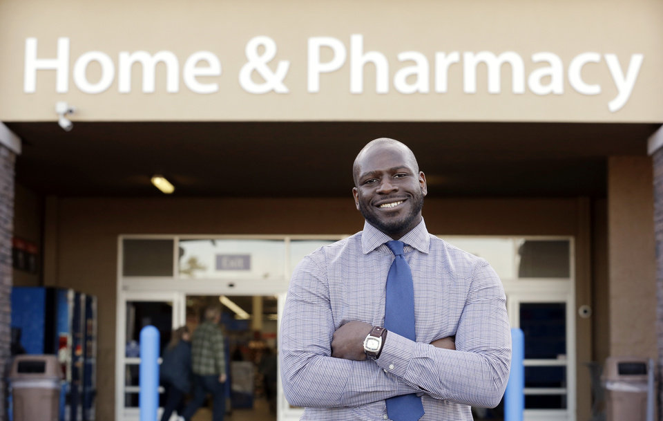Photo - This photo taken Nov. 21, 2013 shows James Lott outside the Wal-Mart store where he works as a pharmacist in Bonney Lake, Wash. Lott, who lives in Renton, Wash., a suburb of Seattle, adds significantly to his six-figure job salary by day-trading stocks. It's not just the wealthiest 1 percent: Fully 20 percent of U.S. adults become rich for parts of their lives, wielding outsized influence on America's economy and politics. And this little-known group may pose the biggest barrier to reducing the nation's income inequality. While the growing numbers of the U.S. poor have been well documented, survey data provided exclusively to The Associated Press detail the flip side of the record income gap: the rise of the
