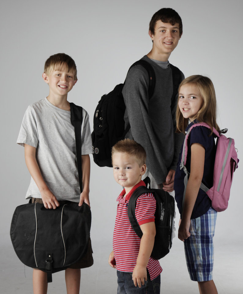 Photo - CHILDREN / KIDS: From left: Will Mecoy, 13; Mac Mecoy, 15; Avery Garrison-Rice, 3; Claire Argo, 8, model backpacks in the OPUBCO studio Thursday, July 23, 2009. Photo by Doug Hoke, The Oklahoman. ORG XMIT: KOD