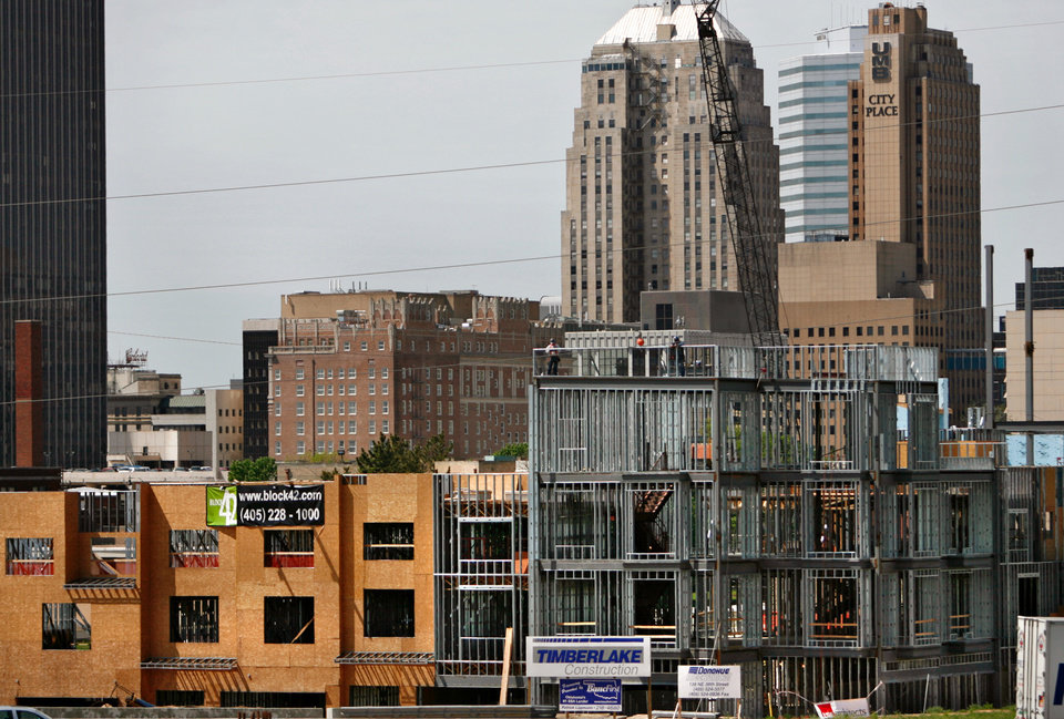 Photo - A file photo shows construction ongoing for the Block 42 high-end housing complex near downtown on Wednesday, April 4, 2007, in Oklahoma City, Okla. Staff photo by CHRIS LANDSBERGER, THE OKLAHOMAN ORG XMIT: KOD  CHRIS LANDSBERGER - THE OKLAHOMAN