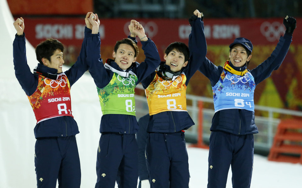 Photo - Japan's Reruhi Shimizu, Taku Takeuchi, Daiki Ito and Noriaki Kasai, from left, celebrate winning the bronze during the ski jumping large hill team competition at the 2014 Winter Olympics, Monday, Feb. 17, 2014, in Krasnaya Polyana, Russia. (AP Photo/Dmitry Lovetsky)