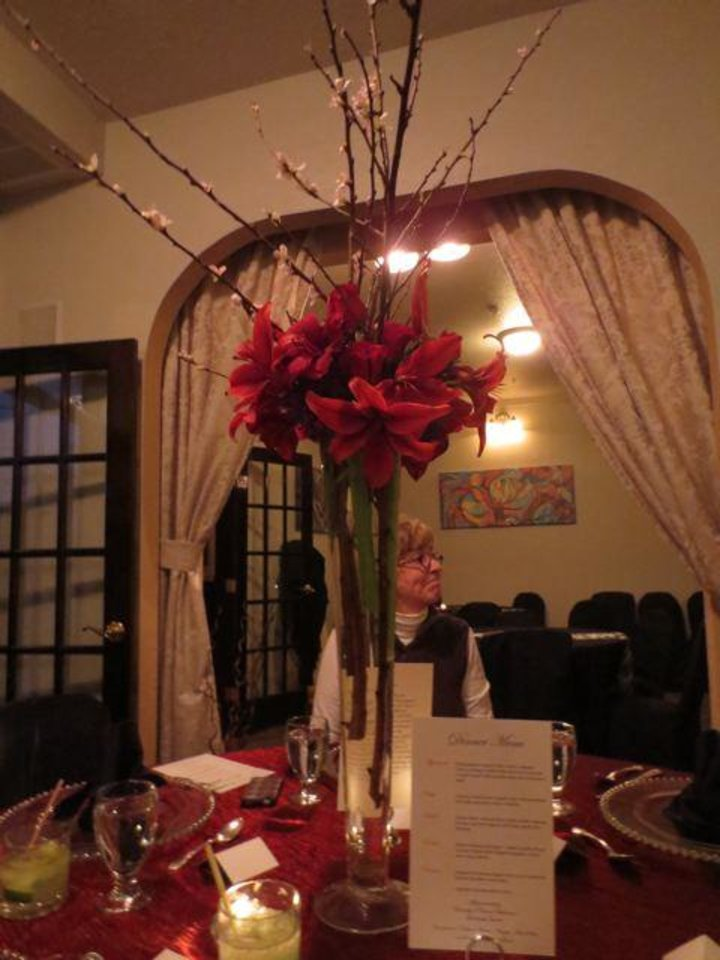 Tall vases of red lilies and flowering branches were on the tables. (Photo by Helen Ford Wallace).