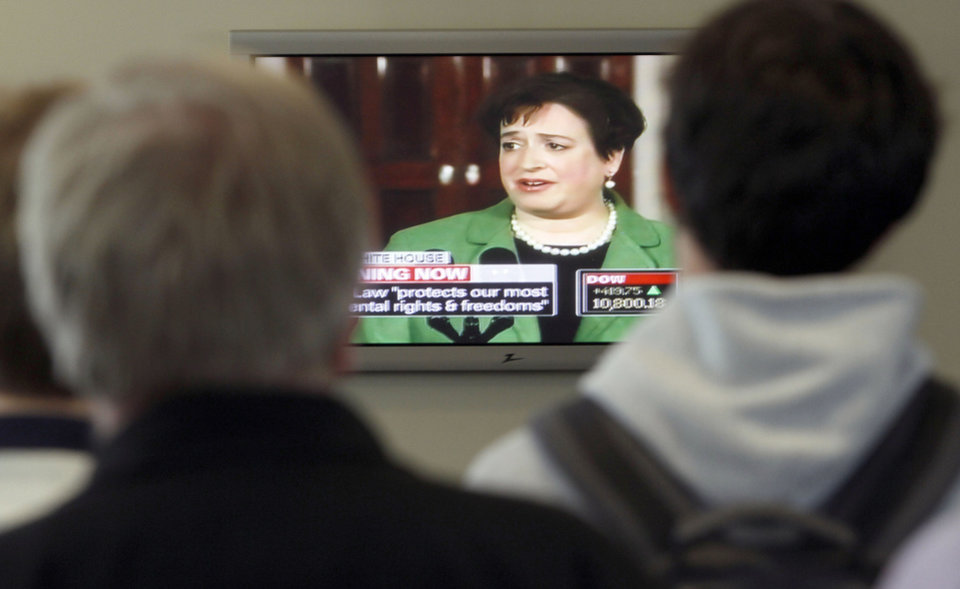 Photo - Harvard University students watch a television Monday at the Harvard Law School in Cambridge, Mass., as former law school dean Elena Kagan talks about being nominated to the U.S.  Supreme Court. AP Photo