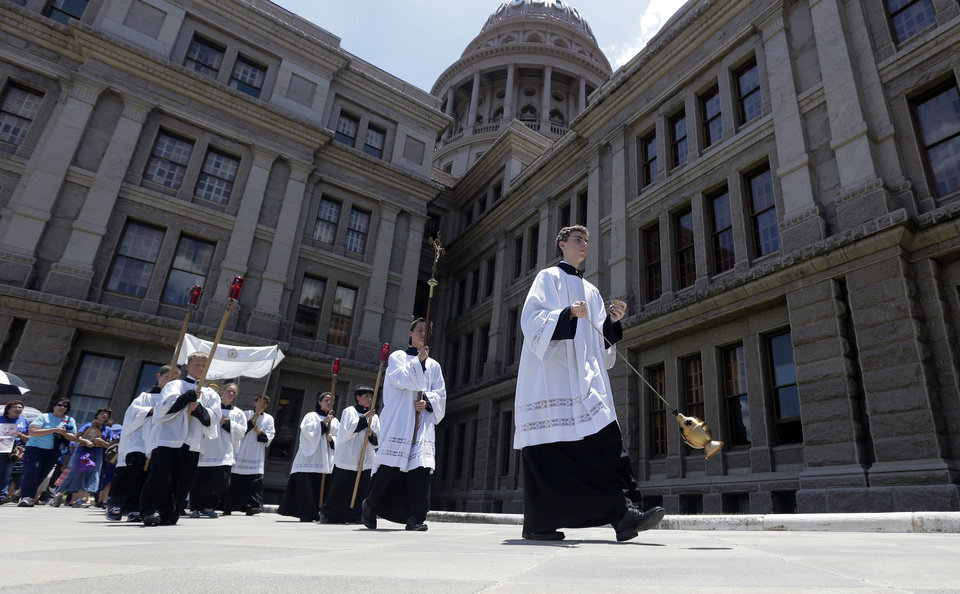 Photo - Anti-abortion supporters take part in a rosary procession around the Texas Capitol as the Texas House  debates HB 2, a bill that will place restrictions on abortion in the state, Tuesday, July 9, 2013, in Austin, Texas. (AP Photo/Eric Gay)