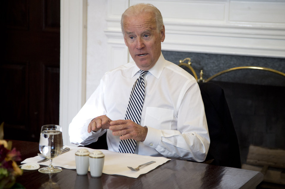 Photo - Vice President Joe Biden gestures as he speaks during a photo-op as he meets with President Barack Obama for lunch in the Private Dining Room of the White House in Washington, Wednesday, Jan. 8, 2014. (AP Photo/Carolyn Kaster)
