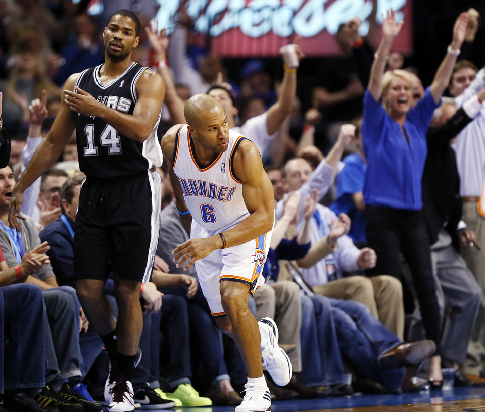 Oklahoma City's Derek Fisher (6) runs back on defense as fans and San Antonio's Gary Neal (14) react to a 3-point shot by Fisher during an NBA basketball game between the Oklahoma City Thunder and the San Antonio Spurs at Chesapeake Energy Arena in Oklahoma City, Thursday, April 4, 2013. Photo by Nate Billings, The Oklahoman