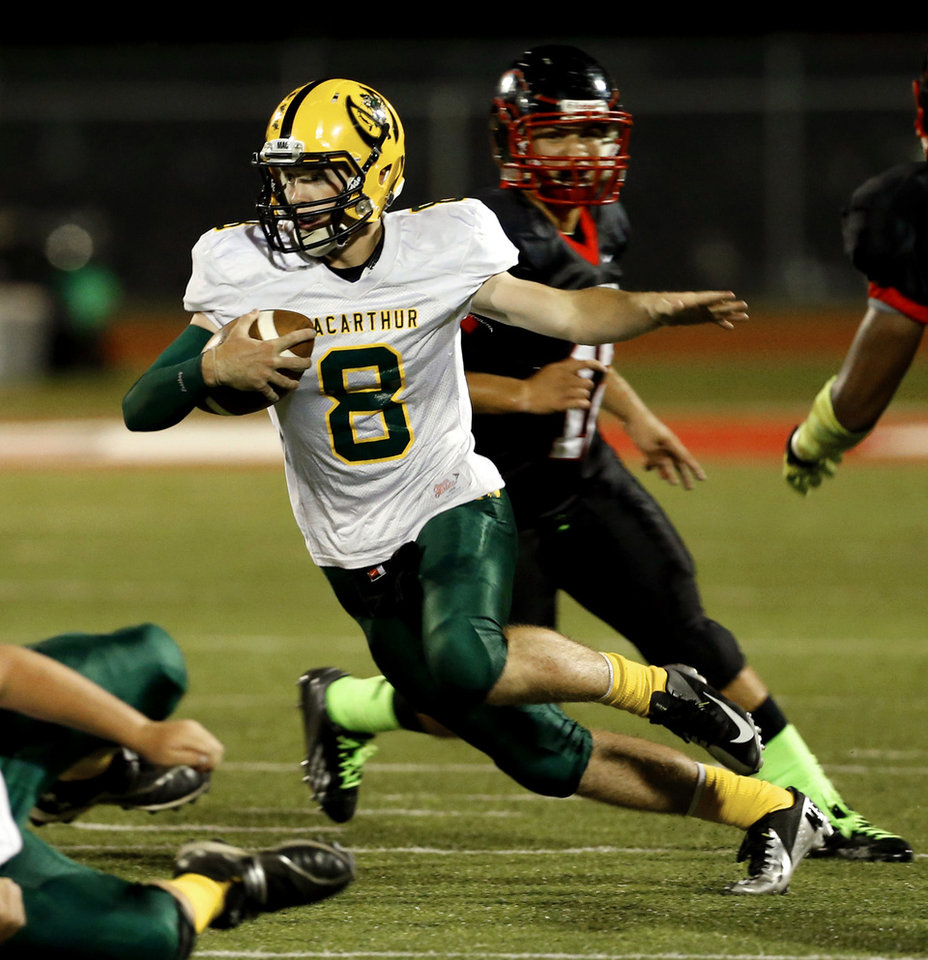 MacArthur's quarterback Will Collins carries during a high school football game between the Lawton MacArthur Highlanders and the Del City Eagles on Friday, Sept. 27, 2013 in Del City, Okla. Photo by Steve Sisney, The Oklahoman