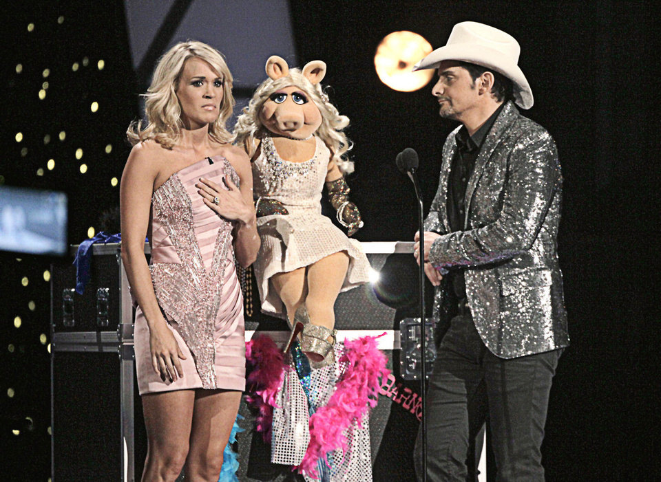 Co-hosts Carrie Underwood, who hails from Checotah, and Brad Paisley talk to Miss Piggy during the 2011 CMA Awards in Nashville, Tenn. AP PHOTO