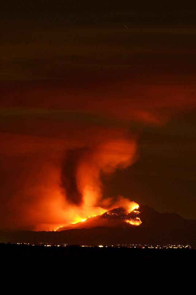 A wildfire burns out of control on the slopes of Mount Diablo in Contra Costa County, Calif., seen from the Woodbridge Ecological Reserve located in the Sacramento–San Joaquin River Delta, Sunday, Sept. 8, 2013. By nightfall, it had surged to 800 acres, state fire officials said, spewing a plume of smoke visible for miles and leading to the evacuation of 50 to 75 homes in Clayton, a town of about 11,000 people alongside the park. (AP Photo/The Modesto Bee, Andy Alfaro) LOCAL TV OUT (KXTV10, KCRA3, KOVR13, FOX40, KMAX31, KQCA58, CENTRAL VALLEY TV); LOCAL PRINT OUT (TURLOCK JOURNAL, CERES COURIER, OAKDALE LEADER, MODESTO VIEW, PATTERSON IRRIGATOR, MANTECA BULLETIN, RIPON, RECROD, SONORA UNION DEMOCRAT, AMADOR LEDGER DISPATCH, ESCALON TIMES, CALAVERAS ENTERPRISE, RIVERBANKS NEWS) LOCAL INTERNET OUT (TURLOCK CITY NEWS.COM, MOTHER LODE.COM)