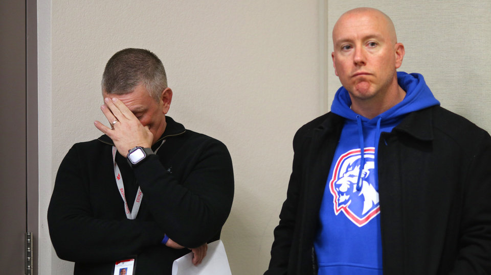 Photo - Moore schools superintendent Dr. Robert Romines and Dustin Horstkoetter react at a news conference about the Moore High School students that were run over by a pickup truck Monday, on Tuesday, February 4, 2020. [Photo by Doug Hoke/The Oklahoman]