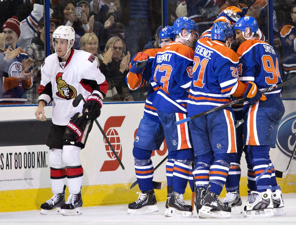 Photo - Ottawa Senators' Kyle Turris (7) skates past Edmonton Oilers' Nail Yakupov (64), Ales Hemsky (83), Andrew Ference (21) and Ryan Smyth (94) as they celebrate a goal during the first period of an NHL hockey game, Tuesday, March 4, 2014 in Edmonton, Alberta. (AP Photo/The Canadian Press, Jason Franson)