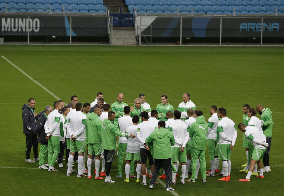 Photo - Algeria's players listen their coach Vahid Halilhodzic during a training session at the Arena do Gremio in Porto Alegre, Brazil, Sunday, June 29, 2014. Algeria will play against Germany on Monday in the round of 16 of the soccer World Cup. (AP Photo/Thanassis Stavrakis)