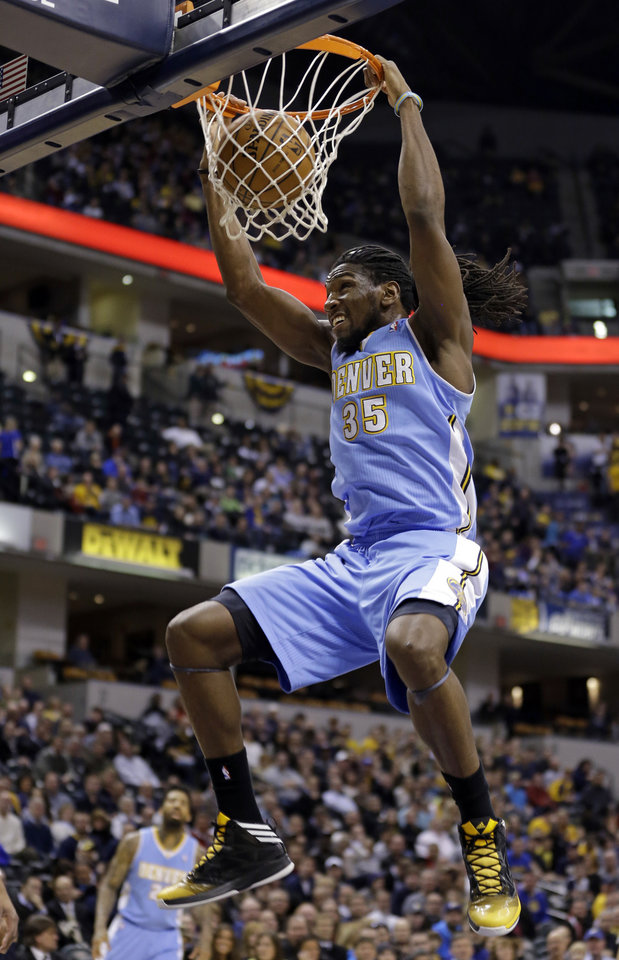 Photo - Denver Nuggets forward Kenneth Faried dunks against the Indiana Pacers in the first half of an NBA basketball game in Indianapolis, Monday, Feb. 10, 2014. (AP Photo/Michael Conroy)