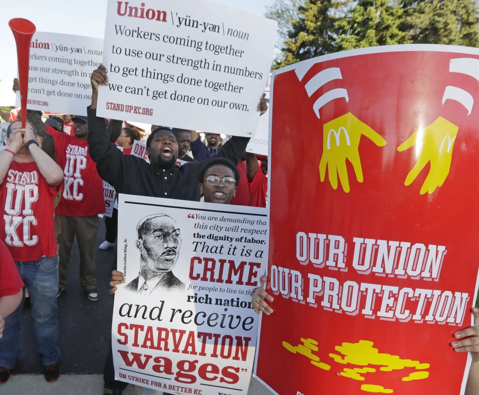 Photo - Hundreds of workers, organizers, and supporters gather outside of the McDonald's Corporation Thursday, May 22, 2014, in Oak Brook, Ill., protesting for a $15 an hour wage and the right to unionize. The group gathered outside the entrance as the company held the annual shareholders meeting. (AP Photo/M. Spencer Green)