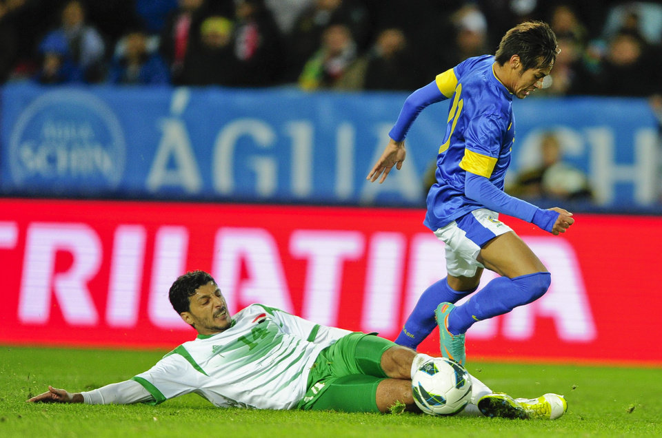 Iraq's Salam Shaker, below, come into contact with Brazil's Neymar, in action during the international friendly soccer match at Swedbank Stadium in Malmo, Sweden, Thursday Oct. 11, 2012. (AP photo / Scanpix Sweden / Bjorn Lindgren) SWEDEN OUT