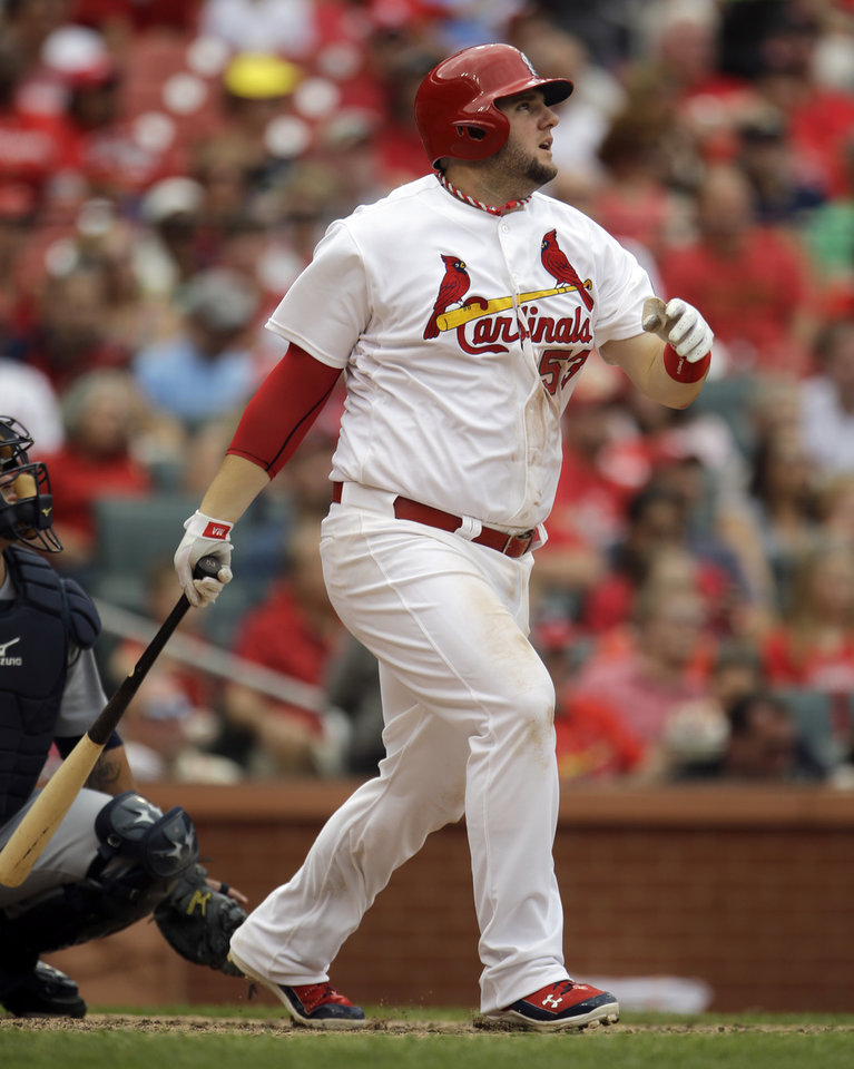 Photo - St. Louis Cardinals' Matt Adams watches his two-run home run during the fifth inning of a baseball game against the Seattle Mariners Sunday, Sept. 15, 2013, in St. Louis. (AP Photo/Jeff Roberson)