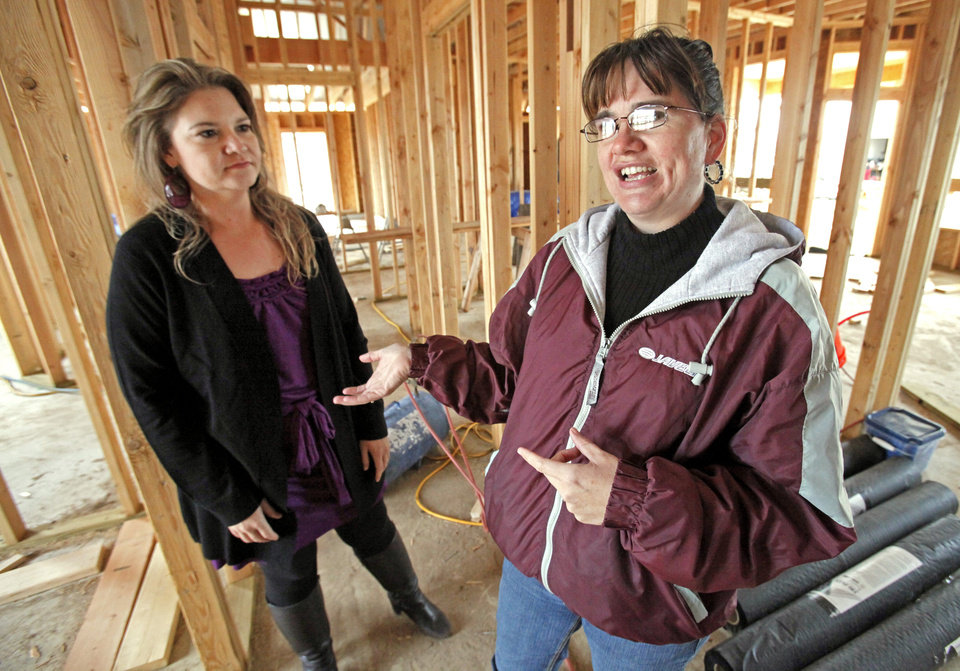 TORNADO DISASTER RECOVERY / TORNADO DAMAGE / HOUSE CONSTRUCTION: Charlene Phillips (right) shows Linda Molsbee, McClain County Long Term Disaster Recovery Committee chairman, her new home on Wednesday, Nov. 16, 2011, in Newcastle, Okla.  The home stands on the site where a 2011 tornado destroyed her home and that of several neighbors.  Photo by Steve Sisney, The Oklahoman ORG XMIT: KOD