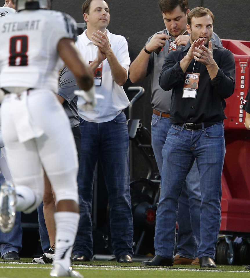 Photo - Wes Welker cheers for Texas Tech during a college football game between the Oklahoma State Cowboys (OSU) and the Texas Tech Red Raiders at Boone Pickens Stadium in Stillwater, Okla., Thursday, Sept. 25, 2014. Photo by Bryan Terry, The Oklahoman